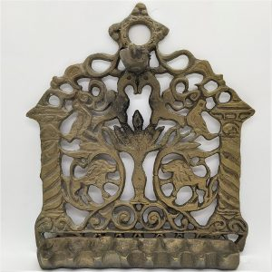 An antique Hanukah Menorah brass Moroccan oil menorah to hang traditional manner to celebrate Hanukah holiday by using olive oil.
