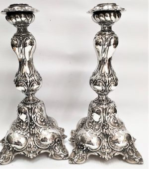 Sterling Silver European Sabbath Candlesticks handmade with embossed designs European style made in Israel. It is filled inside plaster.