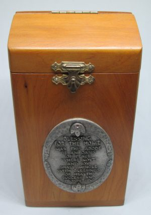 Handmade silver plated brass & Wood Zedaka charity box with home blessings. Dimension 14 cm X 7 cm X 7.6 cm approximately.