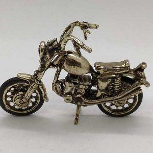 Sterling Silver Miniature Harley Davidson Motorcycle handmade. Handmade sterling Silver Miniature Harley Davidson motorcycle 2.7 cm X 4 cm X 6.1 cm.