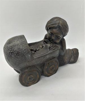 Bronze Statue Baby Carriage led by baby's older sister as common in orthodox big families, older brother and sisters help in daily duties.